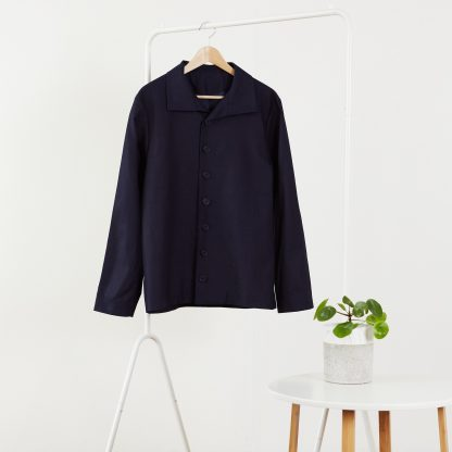 The Litmus Jacket sewing pattern from PH7 Patterns on The Fold Line. A jacket pattern made in cotton and cotton mix, linen and linen mix fabrics, featuring a funnel neck collar, button front and full length sleeves.